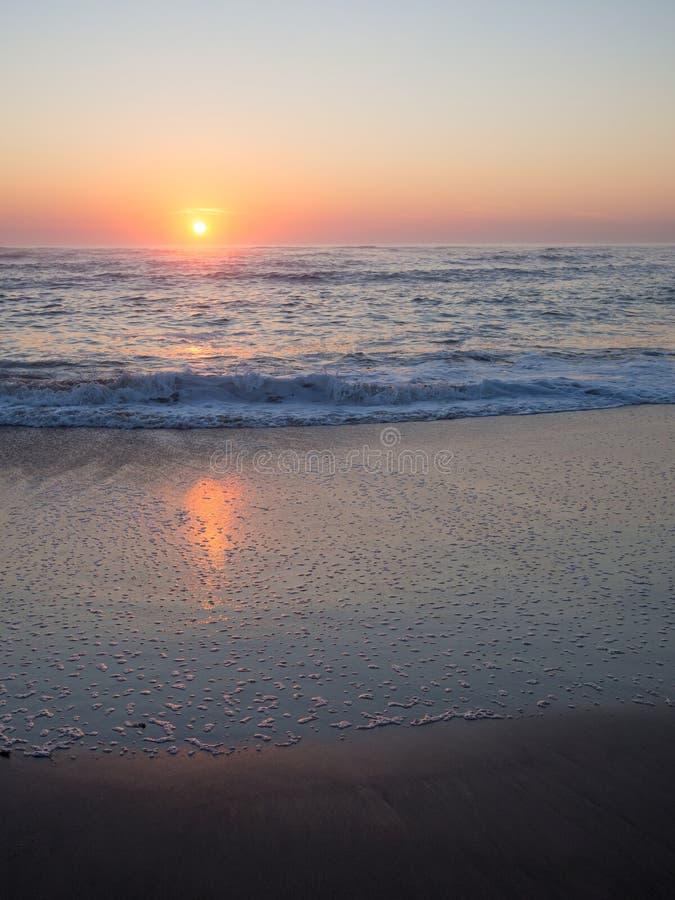 Beautiful sunset over beach at Atlantic ocean coast, Swakopmund, Namibia stock photos