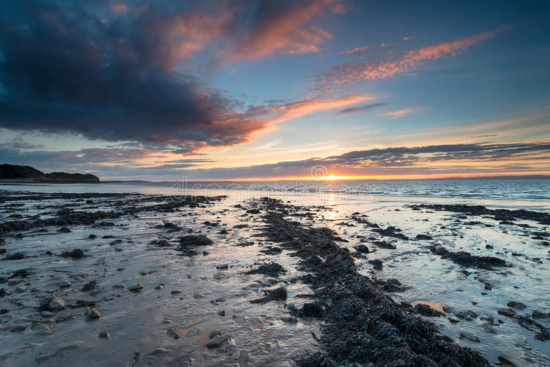 Sunset at Clevedon in Somerset. Beautiful sunset over the beach at Clevedon on the Somerset coast royalty free stock images