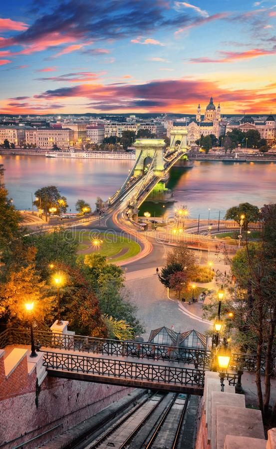 Beautiful sunset over the capital city of Hungary, Budapest. Aerial view with the Danube river, Chain Bridge and the stock photos