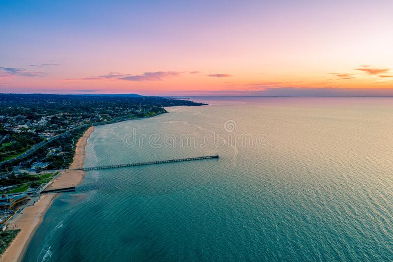 Beautiful sunset over Frankston waterfront. Beautiful sunset over Frankston waterfront and the pier - aerial view with copy space royalty free stock image