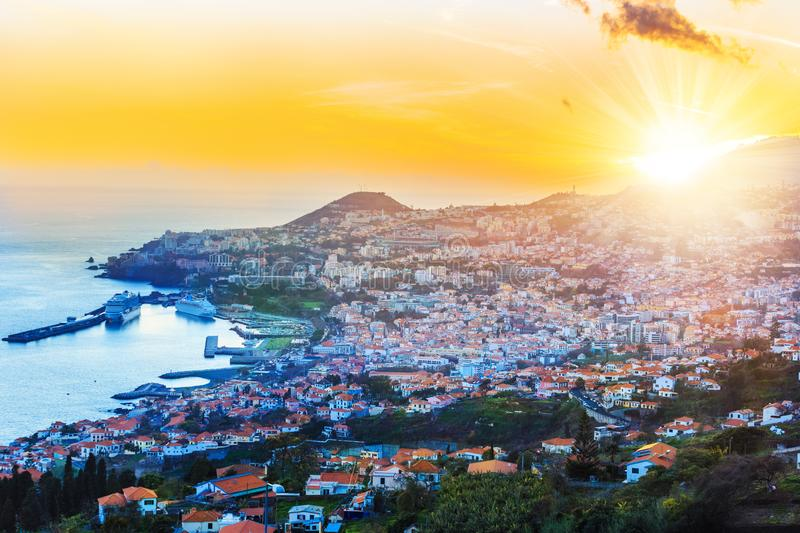 Aerial view, of Madeira island. Beautiful sunset over Funchal capital in Madeira island from air, Portugal royalty free stock photos
