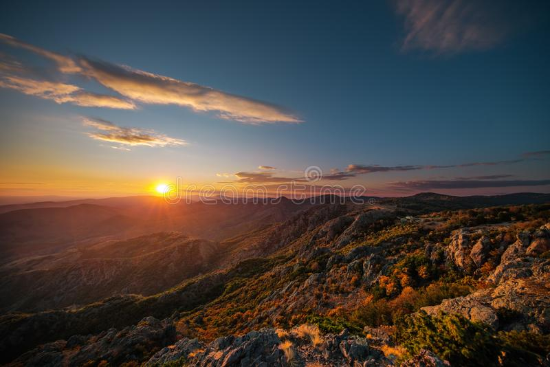 Beautiful sunset over the mountain hills and city, aerial panoramic view royalty free stock images