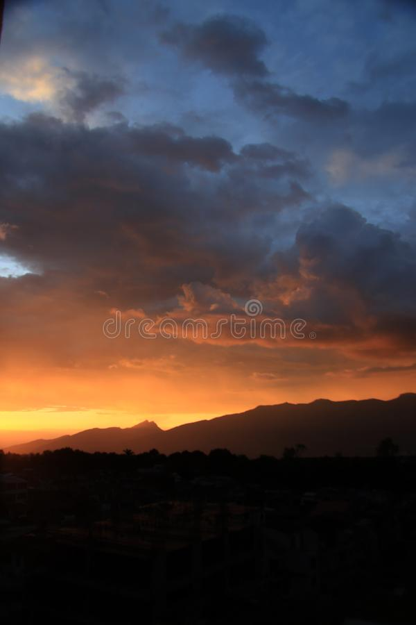Beautiful sunset over the mountains royalty free stock photos