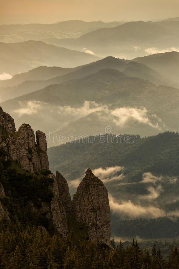 Beautiful sunset over mountains with storm clouds in background. Masivul Ceahlau, Romania stock images