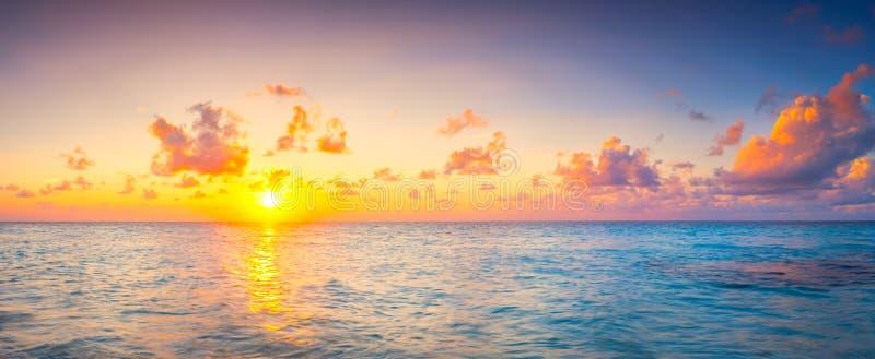 Beautiful sunset over ocean island maldives long panorama stock photography
