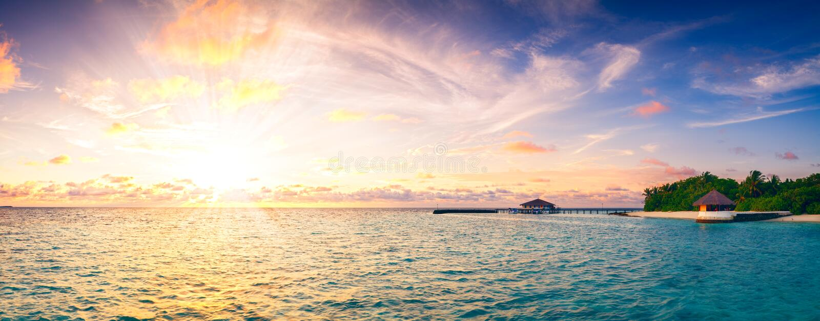Beautiful sunset over ocean island maldives long panorama retro vintage style background royalty free stock photo
