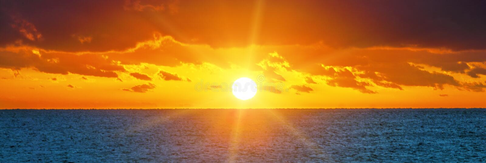 Beautiful sunset over the ocean stock image