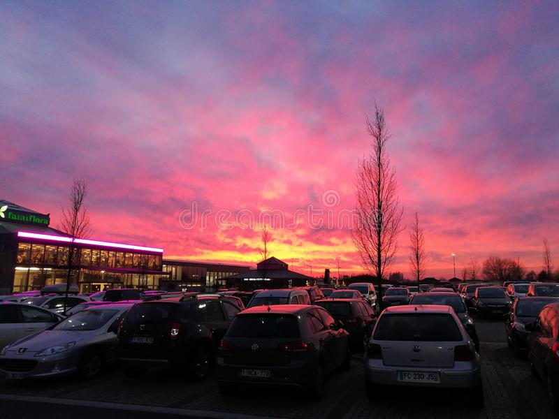 Beautiful sunset over a parking lot. royalty free stock photo