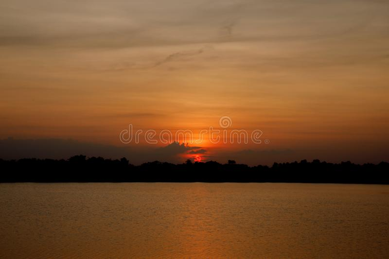 Beautiful sunset over the reservoir Sky background sunset royalty free stock photography