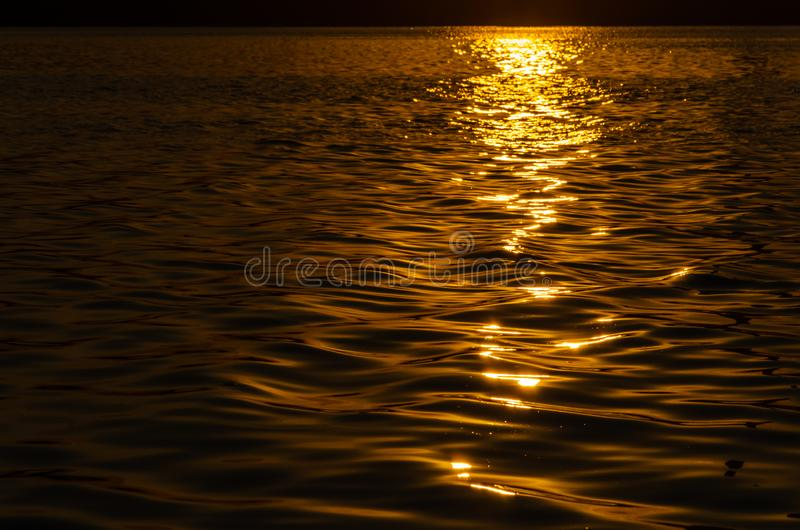 Beautiful sunset over the river. The solar path on the surface of the water. Reflection of the setting sun.  stock image