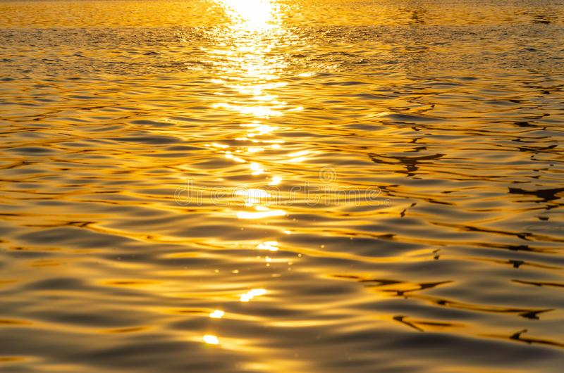 Beautiful sunset over the river. The solar path on the surface of the water. Reflection of the setting sun.  royalty free stock images