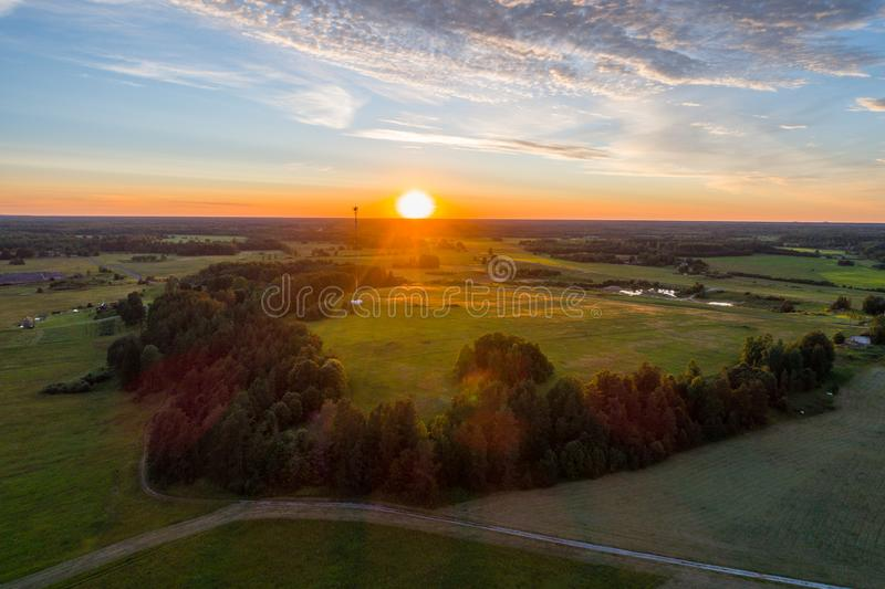 Beautiful sunset over the small town. Fields and trees around. Aerial photography. stock images