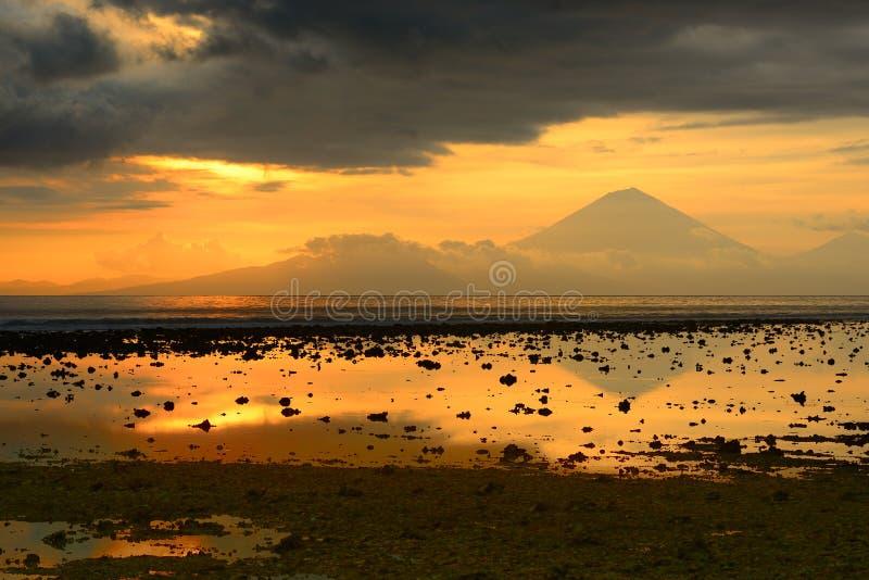 Beautiful sunset over the volcano Agung, Bali by Trawangan island. Indonesia stock image