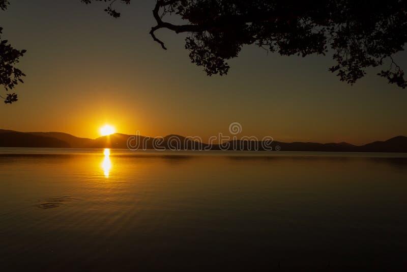 beautiful sunset over Watson Taylors Lake in Crowdy Bay National Park, New South Wales, Australia stock photo