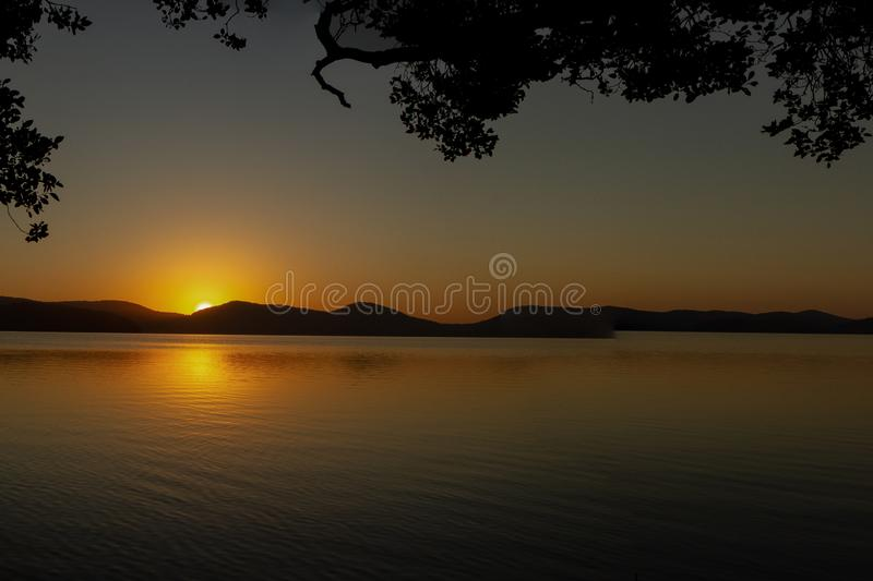 beautiful sunset over Watson Taylors Lake in Crowdy Bay National Park, New South Wales, Australia royalty free stock images