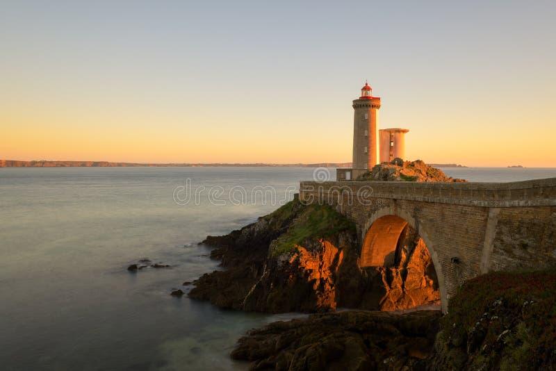 Golden light under the bridge at Le Petit Minou royalty free stock image