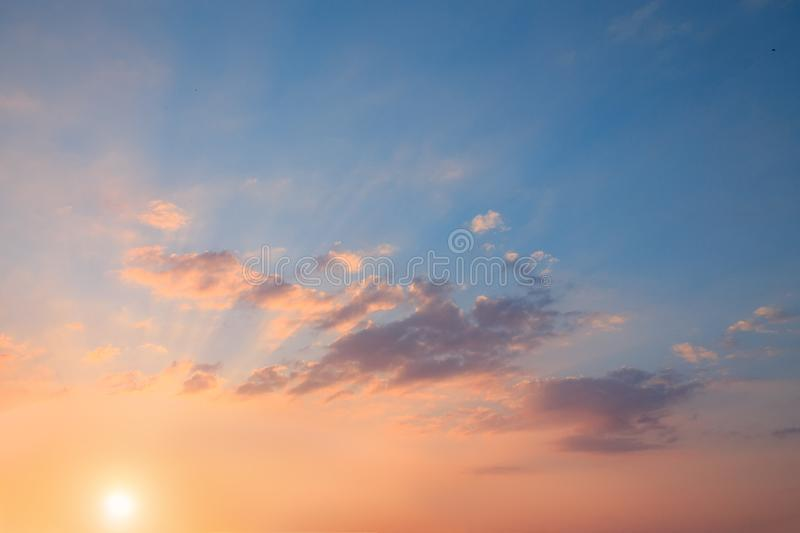 Beautiful sunset with the rays of the sun stock image