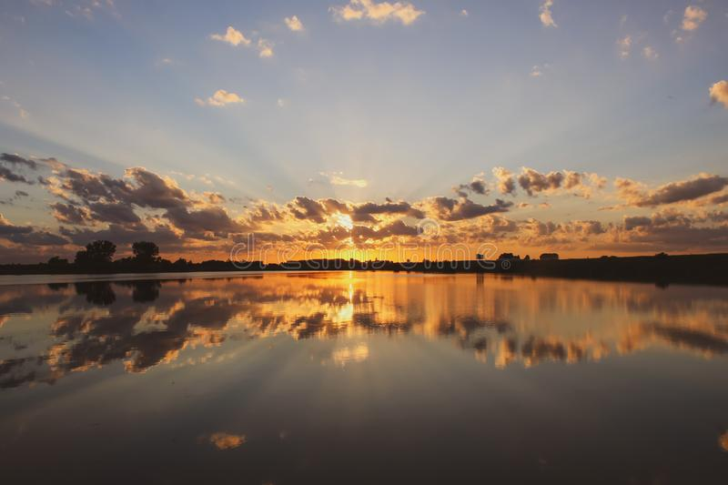 Sunset reflecting off of Grundy County Lake stock photos