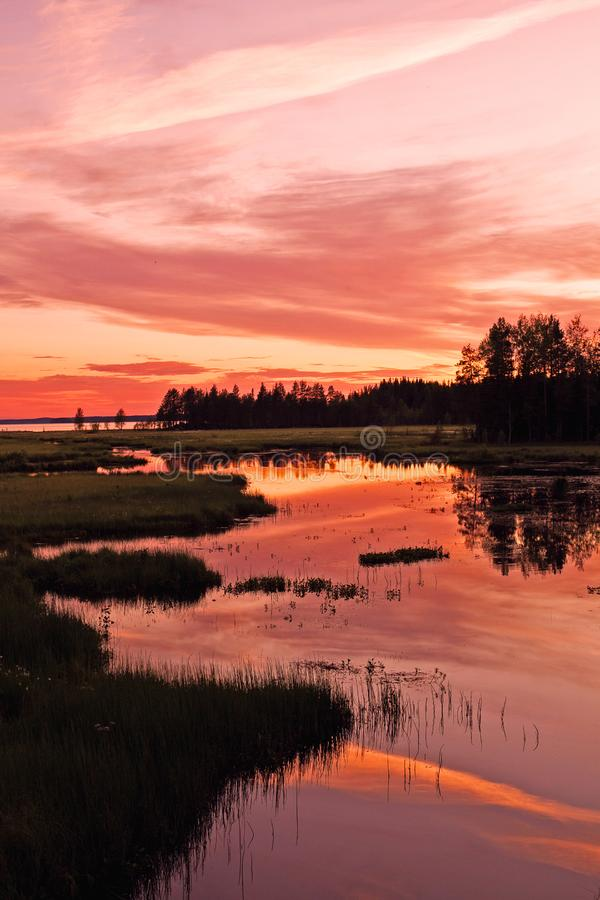 Beautiful sunset reflection in a forest lake. Sunset reflection in a forest lake stock photos