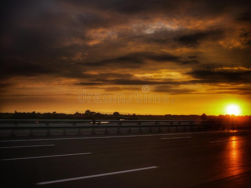 Beautiful sunset in road autumn season, Netherlands. Beautiful sunset in road during autumn season, Netherlands. Nice and awesome landscape stock photography