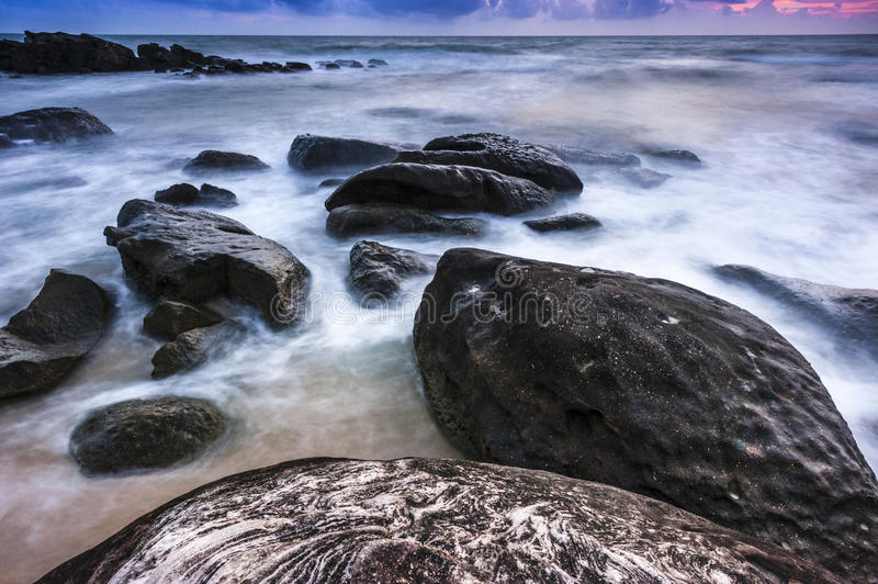 Download Beautiful Sunset With Rocks Stock Image - Image of serene, seascape: 33104575