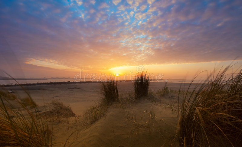 Beautiful sunset and sand dunes stock image