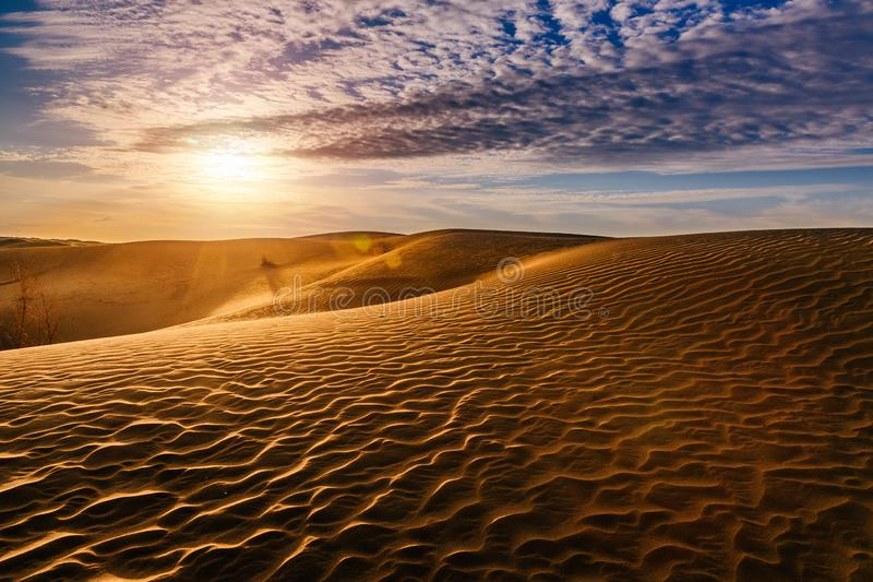 Beautiful sunset in sand dunes over desert royalty free stock photo