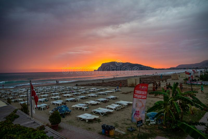 Beautiful sunset scene on Alanya beach royalty free stock photo