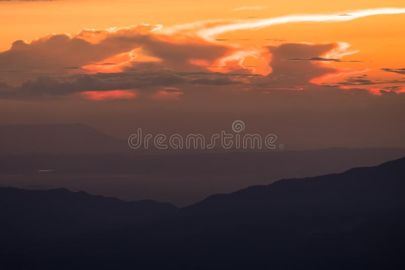 Beautiful sunset scene at high mountain with yellow clouds, Phu chi fah Chiangrai Thailand I. Beautiful sunset scene at high mountain with yellow clouds, Phu chi royalty free stock photo