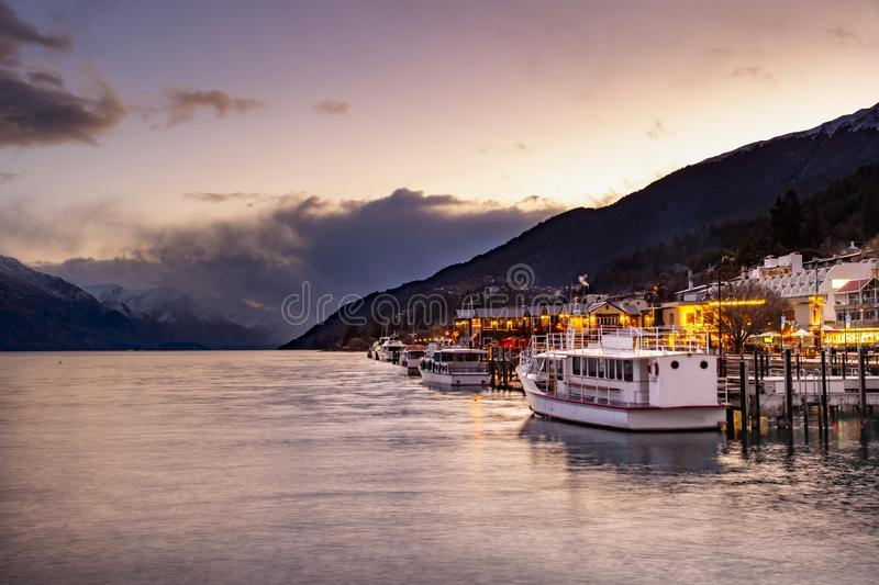 Beautiful sunset scene at pier of lake wakatipu queenstown southland new zealand royalty free stock image