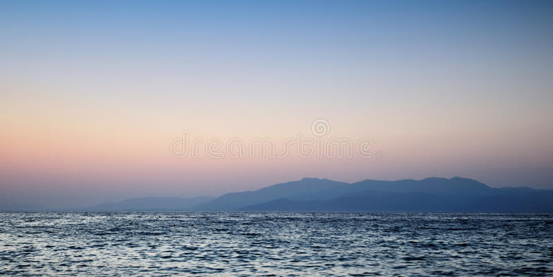 Download Beautiful Sunset On Sea And Mountain Stock Photo - Image of cloud, beautiful: 16026466