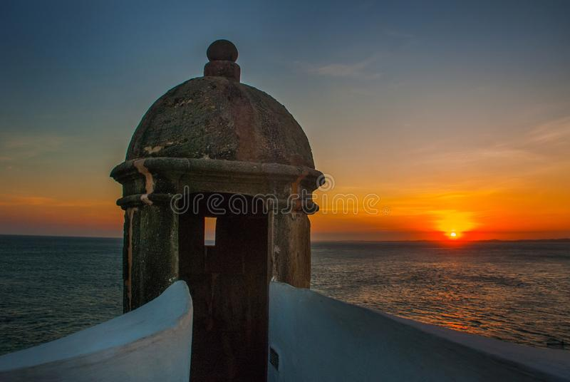Beautiful sunset on the sea. Panoramic view of Barra Lighthouse in Salvador, Bahia, Brazil stock images