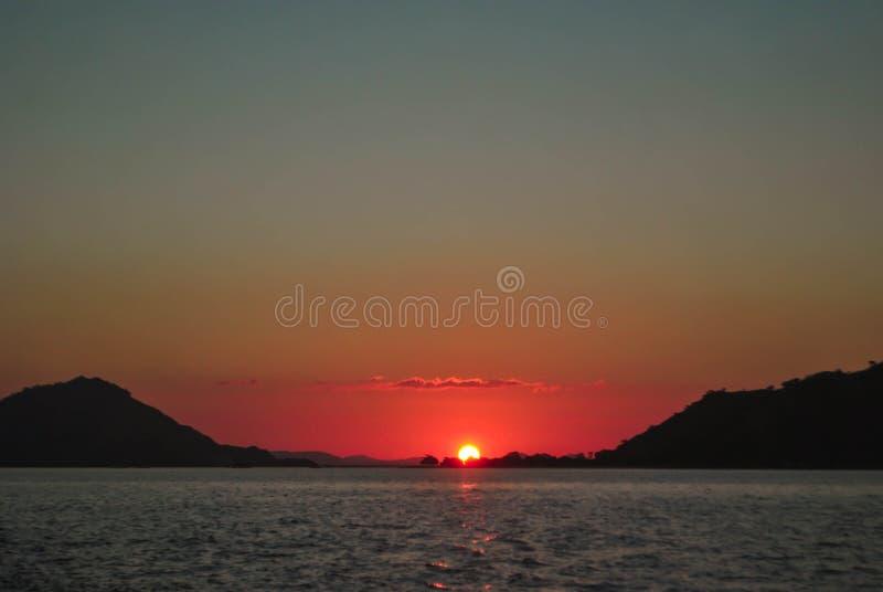 Beautiful sunset on sea sunlight evening background. Beautiful Sunset in tropical Komodo island, Labuan Bajo, Fores, Indonesia. Sunrise, water, landscape stock photography