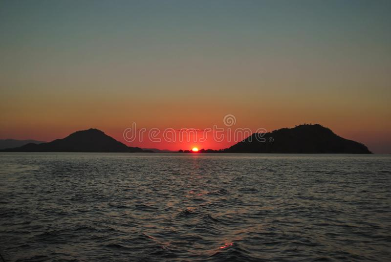 Beautiful sunset on sea sunlight evening background. Beautiful Sunset in tropical Komodo island, Labuan Bajo, Fores, Indonesia. Sunrise, water, landscape royalty free stock images