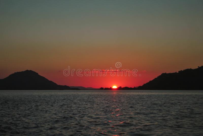 Beautiful sunset on sea sunlight evening background. Beautiful Sunset in tropical Komodo island, Labuan Bajo, Fores, Indonesia. Sunrise, water, landscape stock photo
