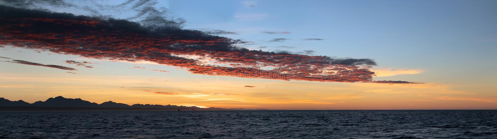 Beautiful Sunset of Seascape with Mountains silhouets. Mossel Bay. South Africa.  royalty free stock photos