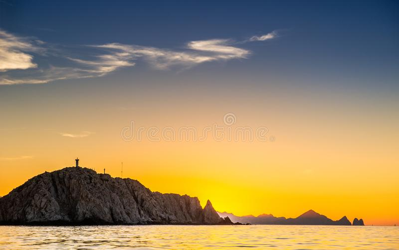 Beautiful Sunset of Seascape with Mountains silhouets. Sea off the Coast of Cabo San Lucas. Gulf of California also known as the stock image