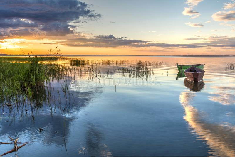 A beautiful sunset on the shore of Pleshcheyevo Lake in Pereslavl-Zalessky, Russia. gold ring of Russia stock photos