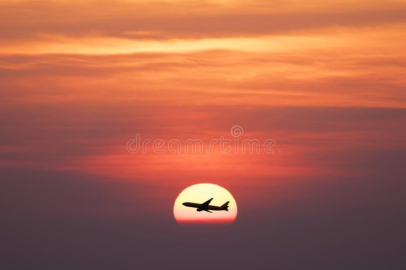 Beautiful sunset with silhoette air plane stock photography