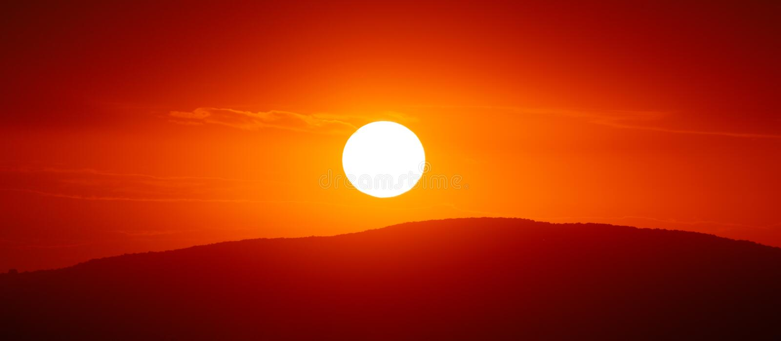 Beautiful sunset sky above clouds with dramatic light.  royalty free stock photo
