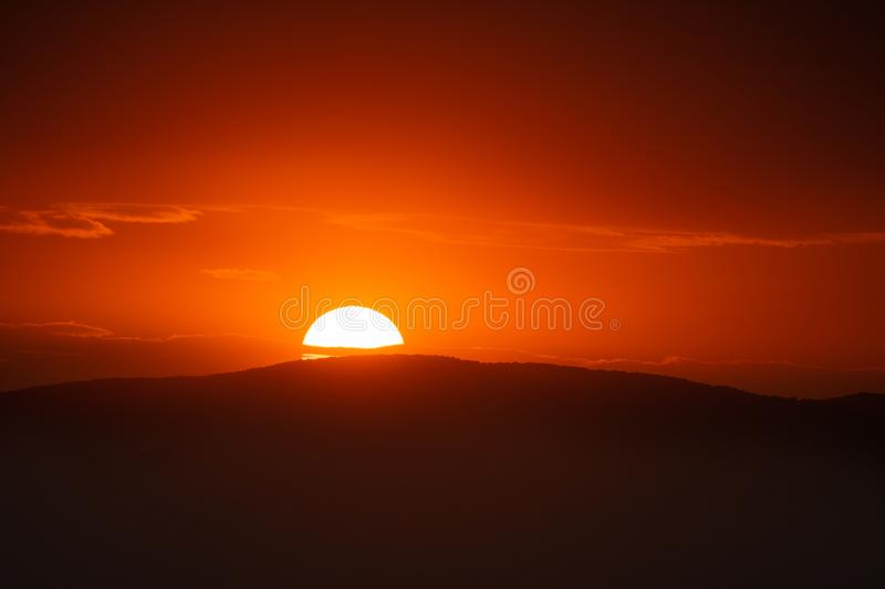 Beautiful sunset sky above clouds with dramatic light.  royalty free stock photos