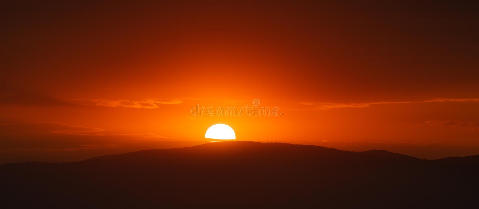 Beautiful sunset sky above clouds with dramatic light.  royalty free stock images