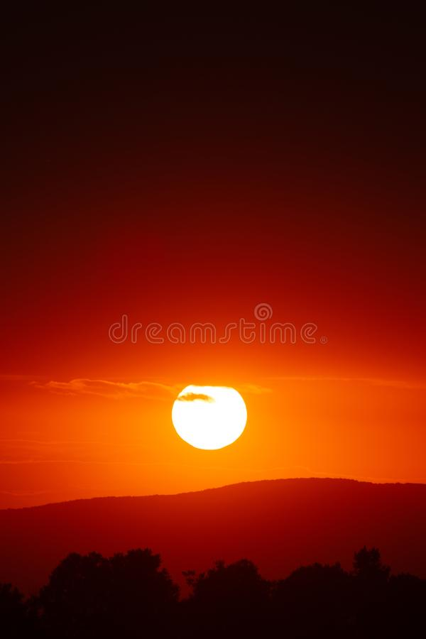 Beautiful sunset sky above clouds with dramatic light.  royalty free stock photography