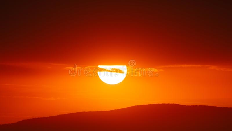 Beautiful sunset sky above clouds with dramatic light.  stock image