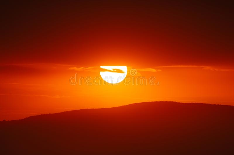 Beautiful sunset sky above clouds with dramatic light.  royalty free stock image
