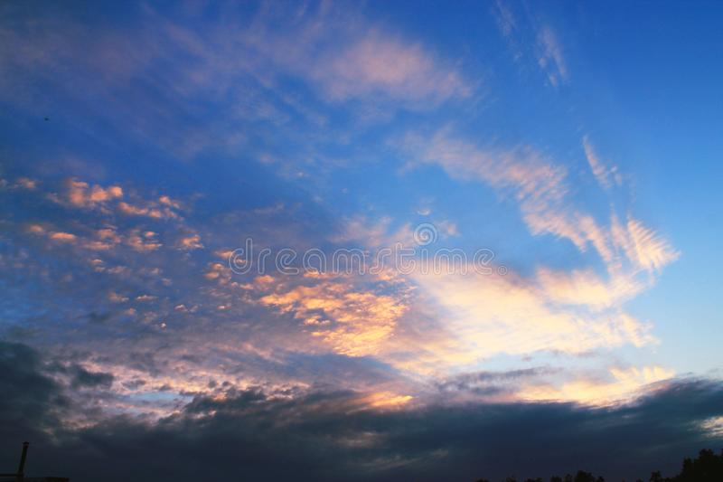 Beautiful sunset sky above clouds with dramatic light. Cabin view stock images