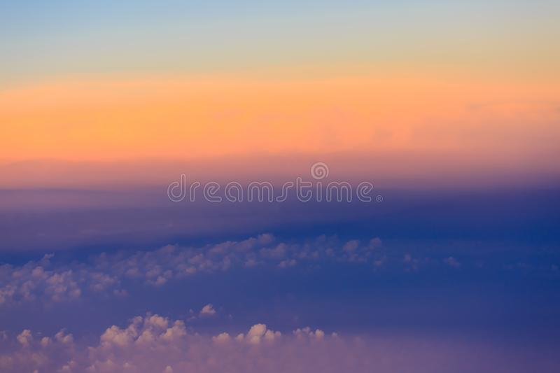 Beautiful sunset sky above clouds with dramatic light royalty free stock photo