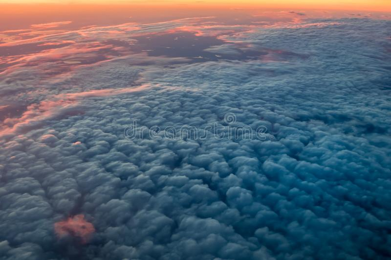 Beautiful sunset sky above clouds with dramatic warm light stock photo