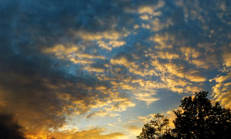 Beautiful heavenly landscape with the sun in the clouds Sky, Bright Blue, Orange And Yellow Colors Sunset. Beautiful Sunset Sky, Bright Blue, Orange And Yellow royalty free stock images