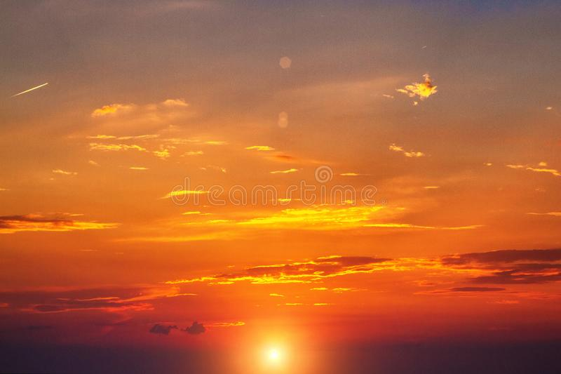 Beautiful sunset sky with bright red clouds.  stock photo